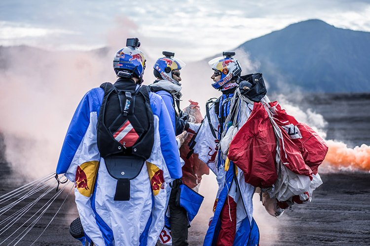 Marco Waltenspiel, Marco Fürst and Georg Lettner on landing area after wingsuit formation above the crater in Bromo National Park, East Java, Indonesia on March 2nd, 2015
