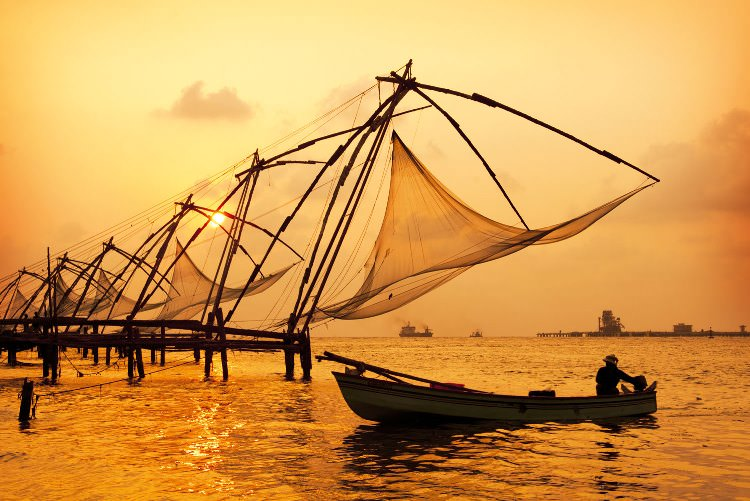 Sunset-over-Chinese-Fishing-nets-and-boat-in-Cochin-Kochi-Kerala-India-shutterstock_104171129