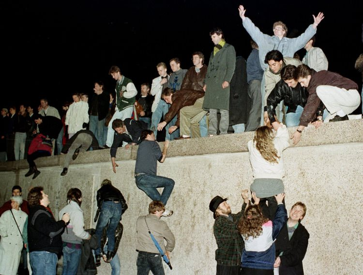 east-germans-celebrated-as-they-climbed-the-berlin-wall-at-the-brandenburg-gate