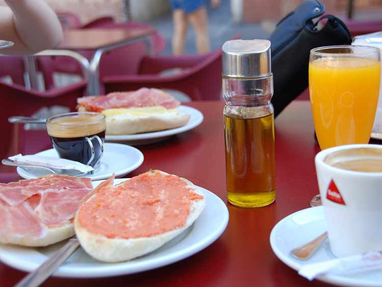 spain-pan-con-tomate-or-toast-with-grated-tomato-spread-is-a-popular-savory-breakfast-in-spain-for-a-treat-many-restaurants-and-vendors-sell-churros
