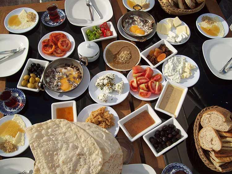 turkey-a-traditional-breakfast-consists-of-bread-cheese-butter-olives-eggs-tomatoes-cucumbers-jam-honey-and-kaymak-it-can-also-include-sucuk-a-spicy-turkish-sausage-and-turkish-tea